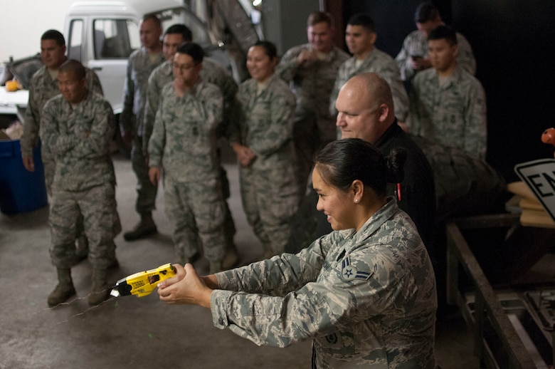 Airman 1st Class Anndora Haraguchi, 154th Security Forces Squadron fireteam member, fires a taser at a target as part of a taser-safety course Feb. 10, 2018, at Gulfport Combat Readiness Training Center, Mississippi.