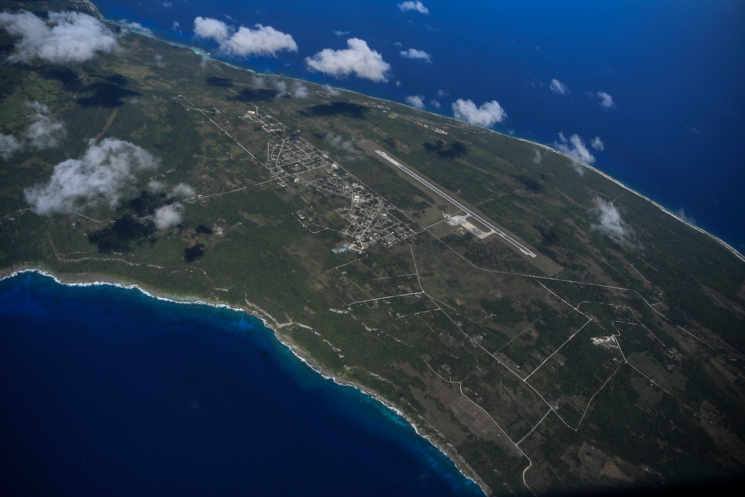 A U.S. Air Force C-130J Super Hercules flies over Tinian, U.S. Commonwealth of the Northern Mariana Islands, during an aeromedical evacuation mission during exercise COPE NORTH 18, Feb. 19.