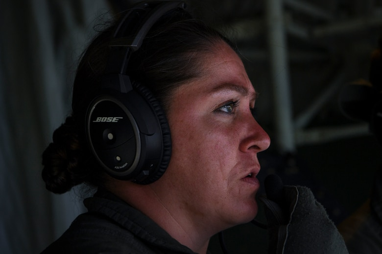 U.S. Air Force Major Catherine Paterson, 439th Aeromedical Evacuation Squadron medical crew director, talks on a communication system during an aeromedical mission at Tinian, U.S. Commonwealth of the Northern Mariana Islands, during exercise COPE NORTH 18, Feb. 19.