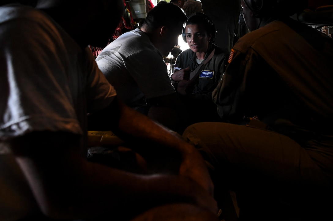 U.S. Air Force Captain Betsy Mayes, 349th Aeromedical Evacuation Squadron flight nurse, treats a simulated patient during an aeromedical mission at Tinian, U.S. Commonwealth of the Northern Mariana Islands, during exercise COPE NORTH 18, Feb. 19.
