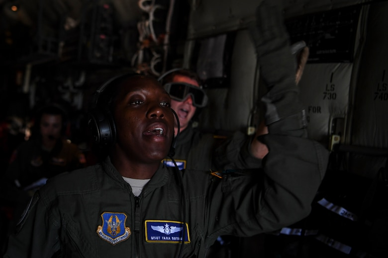 U.S. Air Force Master Sgt. Tara Bryant, 349th Aeromedical Evacuation Squadron technician, communicates with her crew during an aeromedical mission at Saipan, U.S. Commonwealth of the Northern Mariana Islands, during exercise COPE NORTH 18, Feb. 19.