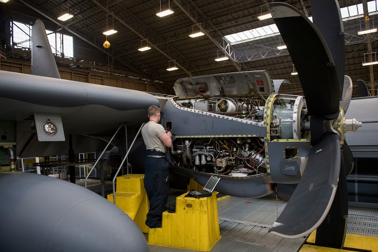 Senior Airman Alexander Forest, 374th Maintenance Squadron maintainer, installs safety cable for fire-loop connections on a C-130J Super Hercules' Rolls Royce AE2100D3 engine, Feb. 22, 2018, at Yokota Air Base, Japan.