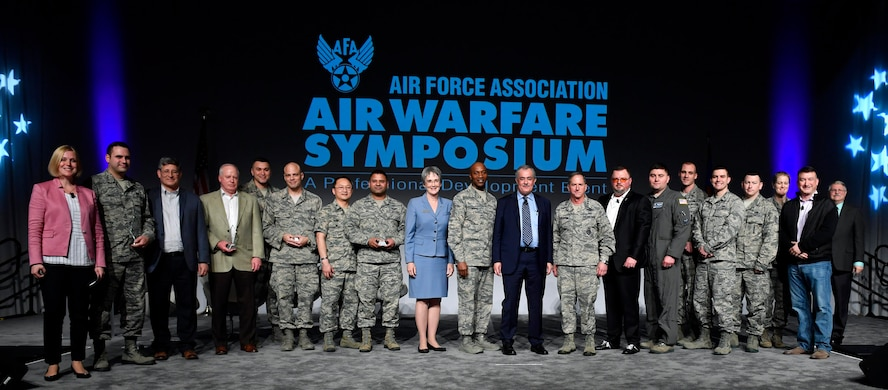 All Spark Tank finalists pose for a photo with members of the panel during the Air Force Association Air Warfare Symposium, Orlando, Fla., Feb. 22, 2018. (U.S. Air Force photo by Wayne A. Clark)