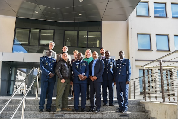 U.S. Air Force Col. Ric Trimillos, U.S. Air Forces in Europe and Africa International Affairs Division chief, and Department of Defense civilians pose with the official party from the Senegal Air Force on Ramstein Air Base, Germany, Feb. 16, 2018. The official party consists of Col. Alimbaye Manga, Senegal Air Force Chief of Staff flight safety advisor, Lt. Col. Aliou Faye, Human Resources Division chief, Maj. Mamadou Wathie, Logistics Division chief, and Capt. Momar Ndiaye, Dakar Operational Center chief and transport pilot.