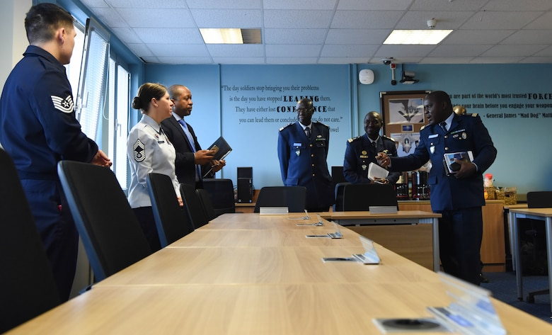 U.S. Air Force Chief Master Sgt. Kathi Glascock, U.S. Air Forces in Europe Kisling Noncommissioned Officer Academy commandant, discusses the Airman Leadership School program with Lt. Col. Aliou Faye, Senegal Air Force chief of the Human Resources Division, about how ALS promotes a learning environment and open discussion at the Kisling NCOA on Kapaun Air Station, Germany, Feb. 16, 2018. On average, 595 students complete ALS on Vogelweh Military Complex every year.