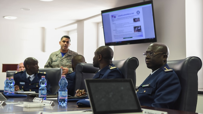U.S. Air Force Staff Sgt. Jose Devora, U.S. Air Forces in Europe international health specialist, gives a presentation to the representatives of the Senegal Air Force at USAFE Headquarters on Ramstein Air Base, Germany, Feb. 16, 2018. The main focus of this presentation was to emphasize on building relationships in international communities.