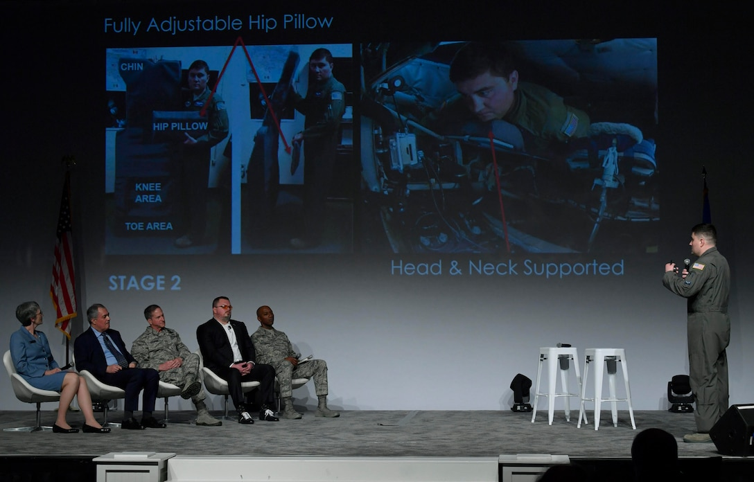 Master Sgt. Bartek Bachleda (right), 22nd Air Refueling Wing aircraft boom operator, from McConnell Air Force Base, Kansas, briefs his idea to the Spark Tank panel during the Air Force Association Air Warfare Symposium, Orlando, Fla., Feb. 22, 2018. (U.S. Air Force photo by Wayne A. Clark)