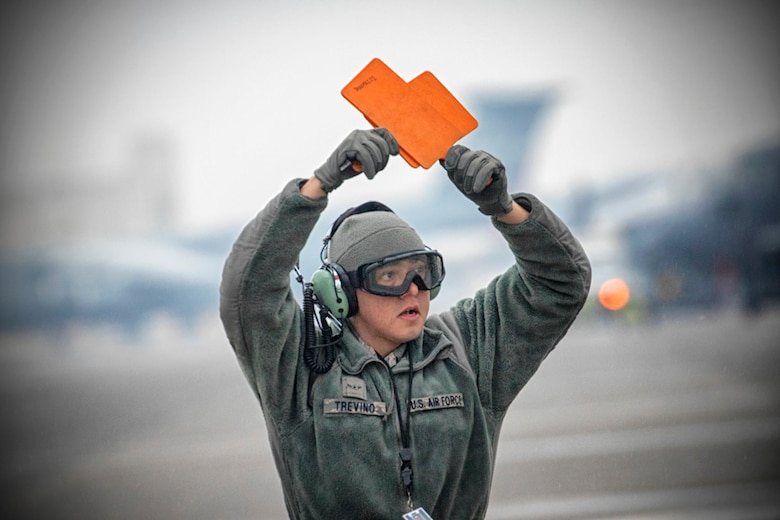 Airman Victor Trevino, 374th Aircraft Maintenance Squadron crew chief, marshals
