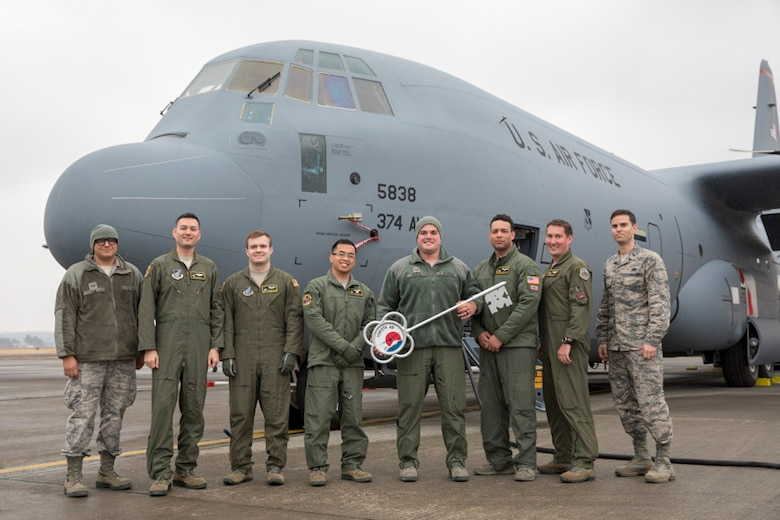 Members of the C-130J Super Hercules number 5838 delivery team pose for a photo