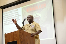 YOKOSUKA, Japan (Feb. 23, 2018) Chief Information Systems Technician Robert Esters gives the keynote address during Commander, U.S. Seventh Fleet 's observance of National African American History Month at Commander, Fleet Activities Yokosuka Auditorium. The program included performances by the U.S. 7th Fleet Band, multimedia presentations and opportunities to try on and wear traditional African clothing.