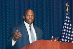 Ken Harvey, former NFL linebacker, describes the sacrifices made by African Americans in the military during a Black History Month observance at the McNamara Headquarters Complex Feb. 21.