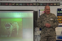 Col. Joseph A. Muhlbauer, the chief of dental professional staff assigned to the 48th Dental Squadron, prepares to give a presentation at Lakenheath Elementary School at Royal Air Force Lakenheath, England, Feb. 20, 2018. Muhlbauer presented an interactive, child-friendly slideshow about dental health in order to keep the young audience entertained. (U.S. Air Force photo/Airman 1st Class Shanice Williams-Jones)