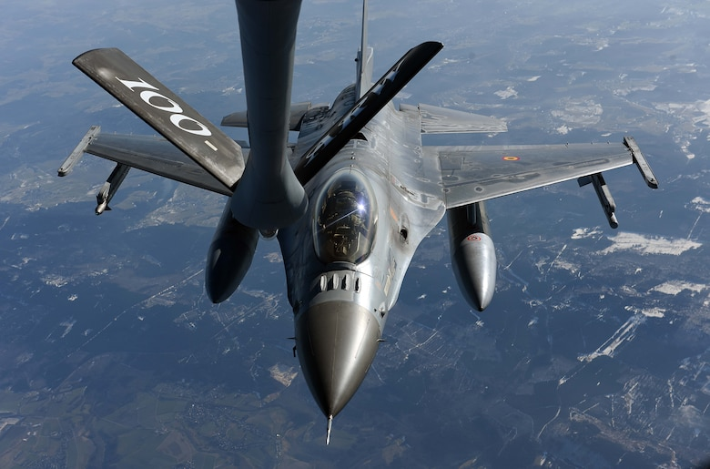 A Belgian Air Component F-16 flies behind a U.S. Air Force KC-135 Stratotanker from the 100th Air Refueling Wing, RAF Mildenhall, England, before receiving fuel over Germany, Feb. 23, 2018. The air refueling was part of a large force exercise with NATO allies including the Belgian, Dutch, French and German air forces.  (U.S. Air Force photo by Airman 1st Class Luke Milano)