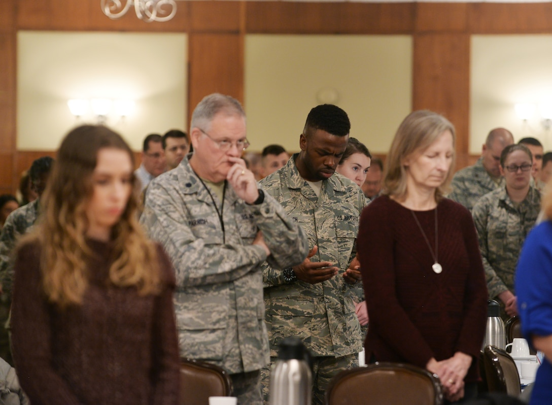 Team Offutt members pray during the National Prayer Breakfast held at the Patriot Club on Offutt Air Force Base, Nebraska, Feb. 15, 2018. The annual event is an opportunity for Department of Defense members, regardless of faith background, to come together and pray for our nation's safety, prosperity, and freedom.