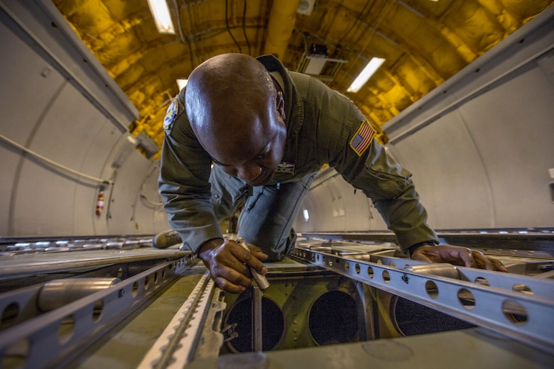 Master Sgt. Greg L. Thomas, a KC-10 Extender flight engineer with the 76th Air Refueling Squadron, 514th Air Mobility Wing, Air Force Reserve Command, performs a pre-flight inspection of the KC-10's cargo hold at Joint Base McGuire-Dix-Lakehurst, N.J., Feb. 15, 2018.