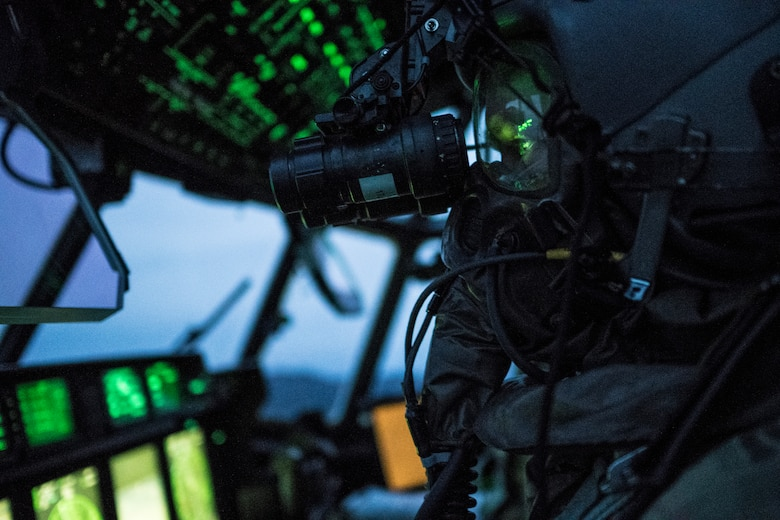 A 17th Special Operations Squadron pilot executes in-flight training with aircrew eye and respiratory protection system equipment Jan. 31, 2018, off the coast of Okinawa, Japan. Aircrew took turns donning equipment in-flight, while the remainder of the crew monitored them as a safety precaution.