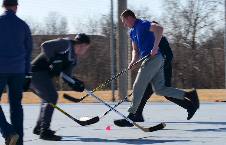 Members of Team Whiteman participate in the first extramural hockey practice at Whiteman Air Force Base, Mo., Feb. 17, 2018. Currently, the Whiteman Fitness Center does not have hockey listed as an intramural sport, but the members hope to raise enough interest to begin building teams within each squadron and host tournaments. (U.S. Air Force photo by Staff Sgt. Danielle Quilla)