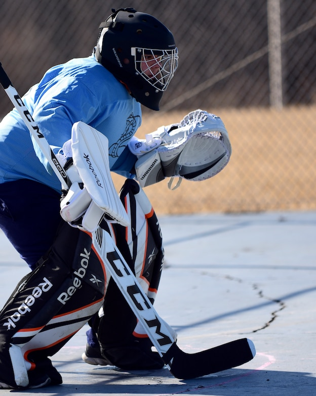 U.S. Air Force Staff Sgt. Aaron Bendel, the extramural hockey goalkeeper from the 509th Munitions Squadron, guards the goal during a practice session at Whiteman Air Force Base, Mo., Feb. 17, 2018. The hockey team was organized by members of the 509th MUNS to provide Team Whiteman with an opportunity to join a team closer to base. (U.S. Air Force photo by Staff Sgt. Danielle Quilla)