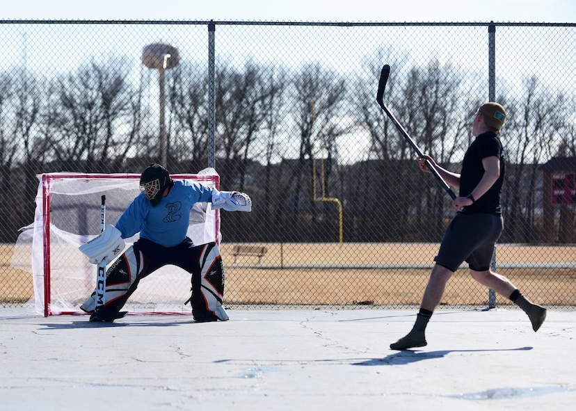 Members of Team Whiteman participate in the first extramural hockey practice at Whiteman Air Force Base, Mo., Feb. 17, 2018. Only one goal and goalkeeper were available for the initial meeting. (U.S. Air Force photo by Staff Sgt. Danielle Quilla)