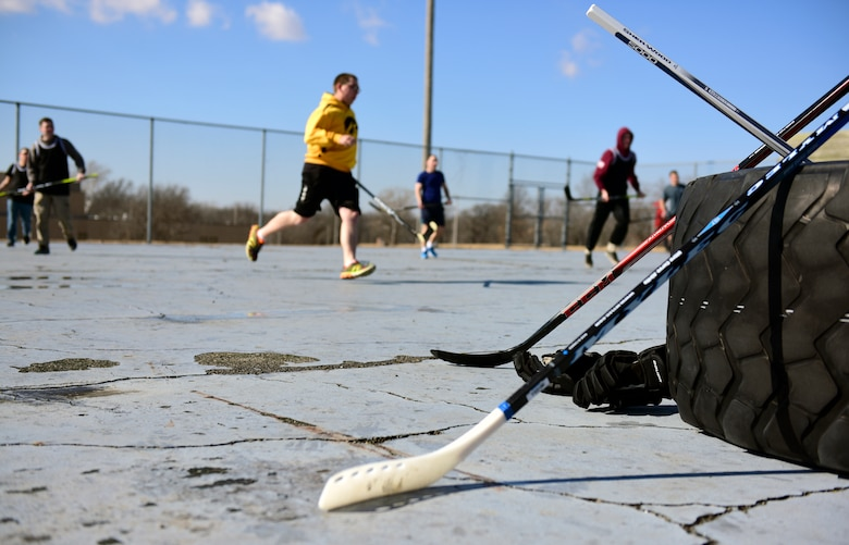 Members of Team Whiteman participate in the first extramural hockey practice at Whiteman Air Force Base, Mo., Feb. 17, 2018. Hockey sticks were available for members who did not have their own gear and jerseys were used to distinguish the teams. (U.S. Air Force photo by Staff Sgt. Danielle Quilla)