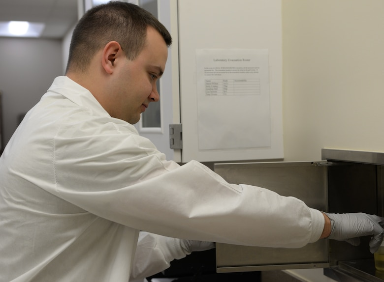 Staff Sgt. Jonathan Hall, 14th Medical Support Squadron NCO in charge of laboratory shipping, receives a urine sample Feb. 20, 2018, on Columbus Air Force Base, Mississippi. Blood and urine tests are common for the laboratory on Columbus AFB, providing doctors with the information they need to diagnose patients for a range of diseases and conditions. (U.S. Air Force photo by Airman 1st Class Keith Holcomb)