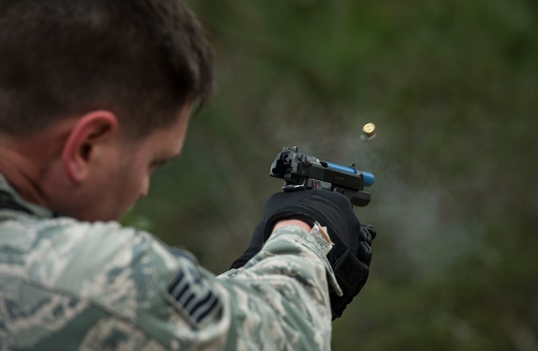 "Tech. Sgt. Stephen O'hara, 23d Security Forces Squadron flight chief, expends extra rounds from an M9 Beretta pistol after a training event, Feb. 22, 2018, at Moody Air Force Base, Ga. ""Shoot, move, communicate"" is a training event that tests participants on their ability to move from barricade to barricade as a team. While one member provided covering fire the others advanced on the enemy, then retreated from the scenario while they maintained cover fire. Security Forces members would employ these tactics anytime they're under enemy fire. (U.S. Air Force photo by Senior Airman Janiqua P. Robinson)"