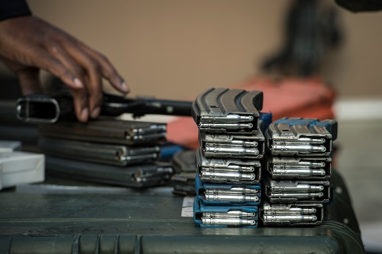 "Ammunition magazines rest on a pelican case before a training event, Feb. 22, 2018, at Moody Air Force Base, Ga. ""Shoot, move, communicate"" is a training event that tests participants on their ability to move from barricade to barricade as a team. While one member provided covering fire the others advanced on the enemy, then retreated from the scenario while they maintained cover fire. Security Forces members would employ these tactics anytime they're under enemy fire. (U.S. Air Force photo by Senior Airman Janiqua P. Robinson)"