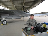 Senior Airman Devon Charmichael, a Low-Observable technician, prepares to launch an F-35A Jan 31, 2018, at Hill Air Force Base, Utah. Launching aircraft is historically done by the crew chief, but 388th FW maintainers participating in the Blended Operational Lightning Technicians, or BOLTs, program are learning other maintainer responsibilities in an effort to create a smaller maintenance footprint. (U.S. Air Force photo)