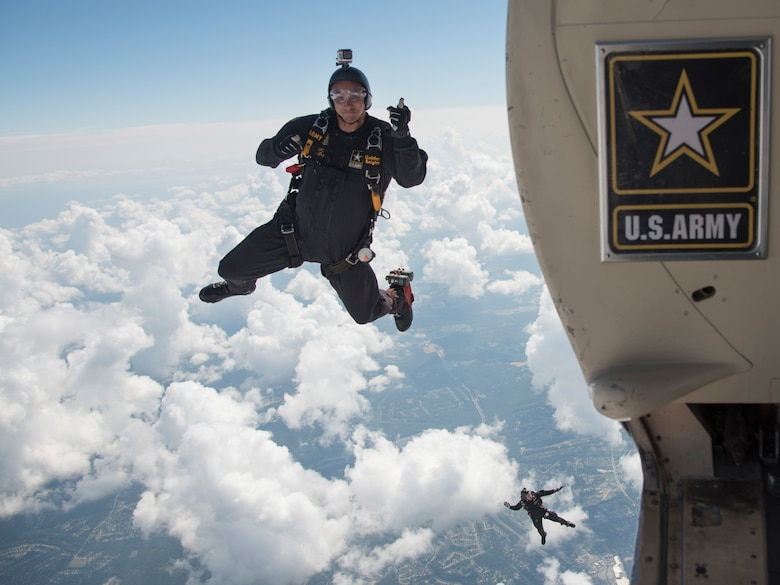 "U.S. Army Parachute Team ""Golden Knights"" members jump out of a C-31 Fokker during the 2017 Joint Base Andrews Air Show: America's Air & Space Expo at JBA, Md., Sept. 17, 2017. The three-day event was in conjunction with the Air Force's 70th anniversary and displayed it capabilities through air power and focused on Science, Technology, Engineering and Math. (U.S. Air Force photo by Airman 1st Class Valentina Lopez)"