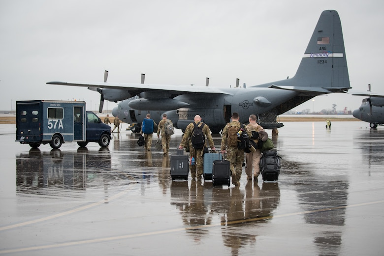 Members of the 123rd Airlift Wing board a C-130 Hercules aircraft at the Kentucky Air National Guard Base in Louisville, Ky., Feb. 23, 2018, prior to deploying to the Persian Gulf region. The Airmen will spend four months flying troops and cargo across the U.S. Central Command area of responsibility, which Includes Iraq, Afghanistan and northern Africa.