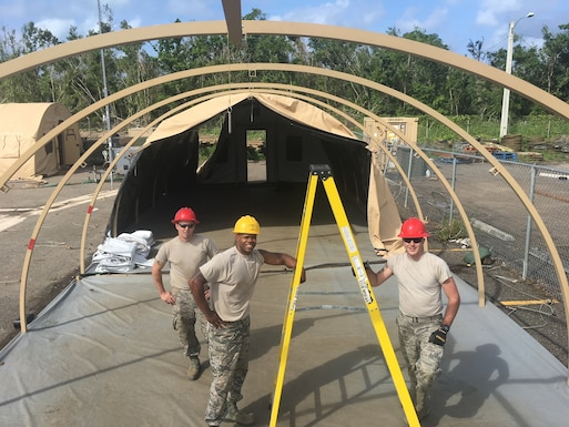 Civil Engineers from the 102nd Intelligence Wing, Otis Air National Guard Base, Cape Cod, Massachusetts, work at Camp Tortuguero, Vega Baja, Puerto Rico in December 2017. The National Guard was mobilized to provide disaster relief in the aftermath of Hurricane Maria.