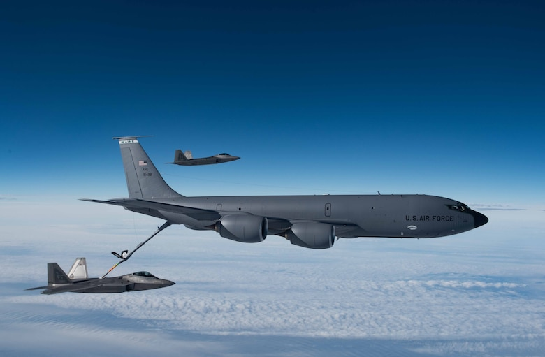 A KC-135 Stratotanker from the 101st Air Refueling Wing refuels F-22 Raptors from the 94th Fighter Squadron over the Atlantic Ocean, Feb. 22, 2018.