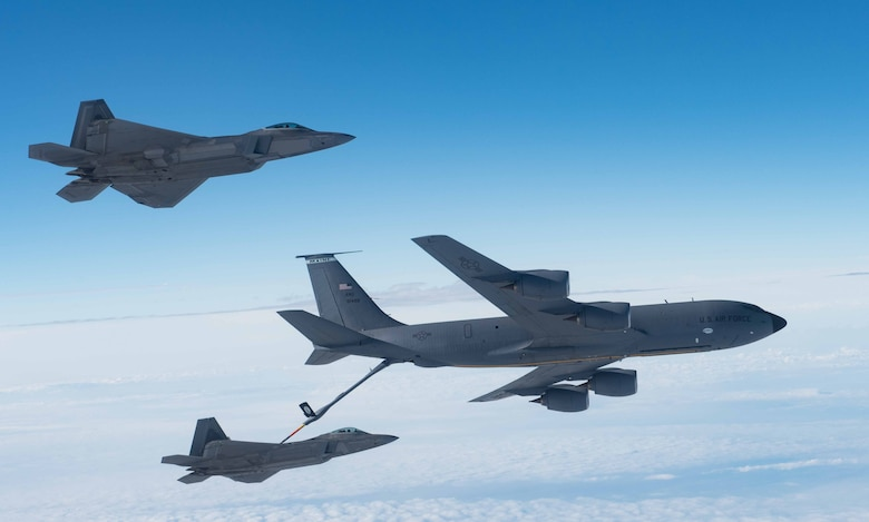A KC-135 Stratotanker from the 101st Air Refueling Wing refuels F-22 Raptors from the 94th Fighter Squadron over the Atlantic Ocean, February 22, 2018.