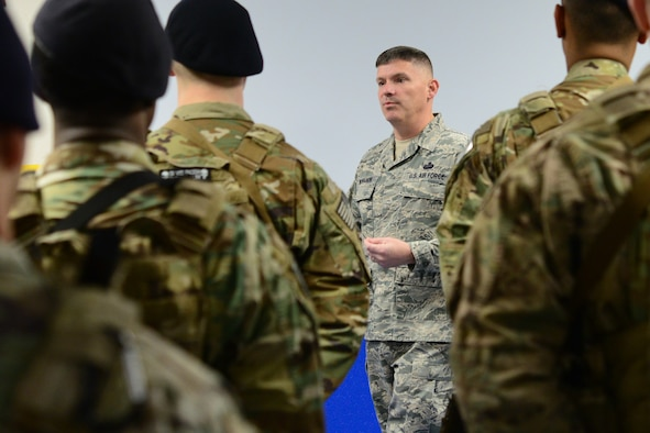 Chief Master Sgt. Patrick McMahon, senior enlisted leader of U.S. Strategic Command, addresses Airmen from the 841st Security Forces Squadron during guardmount Feb. 23, 2018, at Malmstrom Air Force Base, Mont.