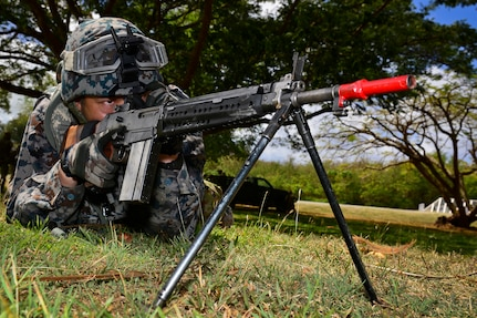 A Japan Air Self-Defense Force member protects a perimeter during search and rescue  medical evacuation operations training during exercise Cope North 18 in Tinian, Northern Marianas Islands.