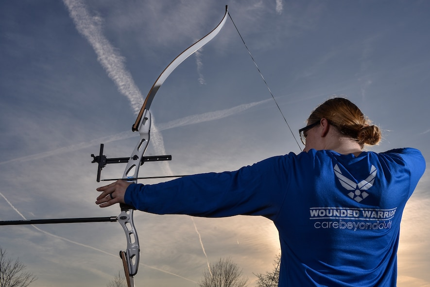 Senior Airman Karah Behrend, Air Force Wounded Warrior, poses for a portrait with her recurve bow that she practices with at Fort George G. Meade, Md., Feb. 7, 2018. Behrend was diagnosed with Reflex Sympathetic Dystrophy (RSD) in 2015. She became an Air Force Wounded Warrior in 2016 and is competing in the 2018 Wounded Warriors team trial for the Air Force. (U.S. Air Force by Staff Sgt. Alexandre Montes)