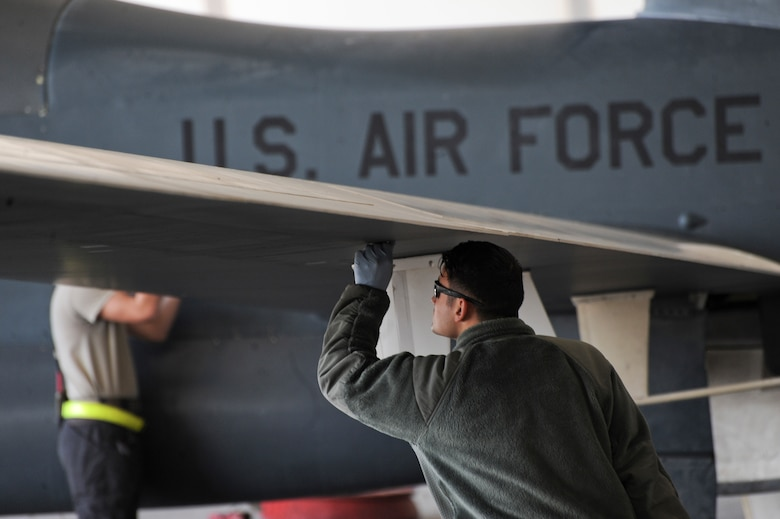 U.S. Air Force Airman 1st Class Christian De Jesus Roman, 380th Expeditionary Aircraft Maintenance Squadron crew chief, conducts post and preflight inspections on an RQ-4 Global Hawk Feb. 13, 2018 on Al Dhafra Air Base. The RQ-4 Global Hawk is a high-altitude, long-endurance, remotely piloted aircraft with an integrated sensor suite that provides global all-weather, day or night intelligence, surveillance and reconnaissance (ISR) capability. (U.S. Air Force photo by Airman 1st Class D. Blake Browning)