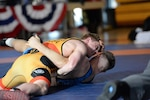 Michael Hooker of the U.S. Army presses for a fall against Peyton Walsh of the U.S. Marines at 77 kg. Photo by LT Joe Painter, U.S. Navy