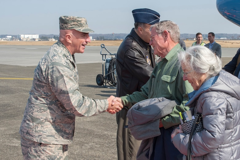 Col. Kenneth E. Moss, 374th Airlift Wing commander, shakes hands with Sen. James Inhofe, R-O.K., at Yokota Air Base, Japan, Feb. 24, 2018.