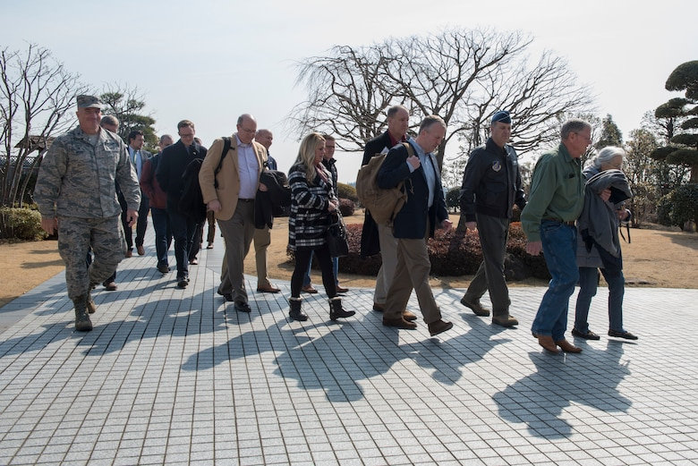 Lt. Gen. Jerry P. Martinez, United States Forces Japan and 5th Air Force commander, and Col. Kenneth E. Moss, 374th Airlift Wing commander, walk with the congressional delegation of Sen. James Inhofe, R-O.K., after their arrival at Yokota Air Base, Japan, Feb. 24, 2018.