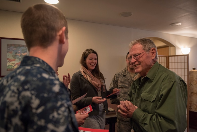 Sen. James Inhofe, R-O.K., shares cards with service members from Oklahoma during a meet and greet at Yokota Air Base, Japan, Feb. 25, 2018.