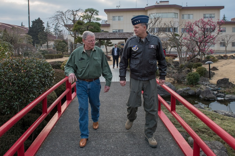 Lt. Gen. Jerry Martinez, United States Forces Japan and 5th Air Force commander, walks with Sen. James Inhofe, R-O.K., a senior member of the Senate Armed Services Committee, at Yokota Air Base, Japan, Feb. 25, 2018.