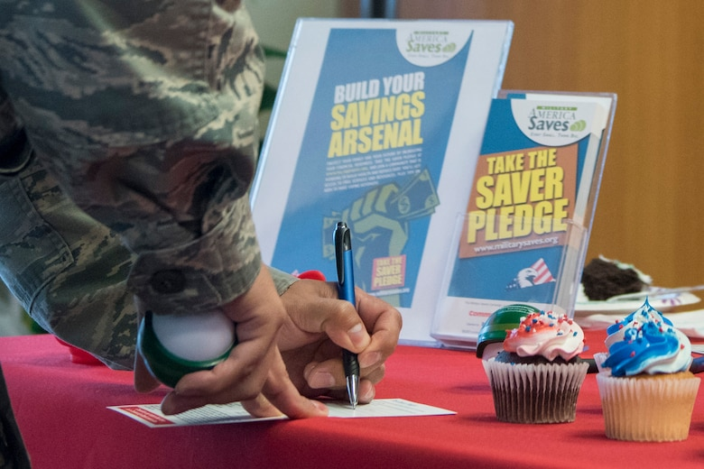 An Airman takes the saver's pledge as part of the Military Saves campaign at Yokota Air Base, Japan, Feb. 26, 2018.