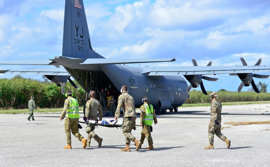 U.S. Air Force (USAF), Koku Jieitai (Japan Air Self-Defense) and Royal Australian Air Force members (RAAF) utilize a USAF C-130J Super Hercules  to perform logistical re-supply, medical evacuation, troop movement and humanitarian assistance during exercise COPE NORTH 18 at Tinian, U.S. Commonwealth of the Northern Marianas Islands, Feb. 19. Through exercises and engagements during COPE NORTH, USAF, Koku Jieitai and RAAF increase interoperability for humanitarian assistance/disaster relief operations. (U.S. Air Force photo by Airman 1st Class Christopher Quail)