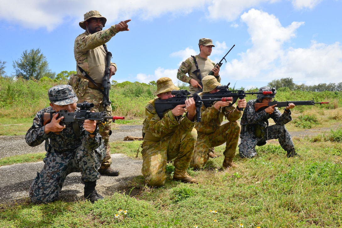 U.S. Air Force (USAF), Koku Jieitai (Japan Air Self-Defense) and Royal Australian Air Force (RAAF) members defend a perimeter during a training scenario in exercise COPE NORTH 18 at Tinian, U.S. Commonwealth of the Northern Marianas Islands, Feb. 20. Through exercises and engagements during COPE NORTH, USAF, Koku Jieitai and RAAF increase interoperability for humanitarian assistance/disaster relief operations. (U.S. Air Force photo by Airman 1st Class Christopher Quail)