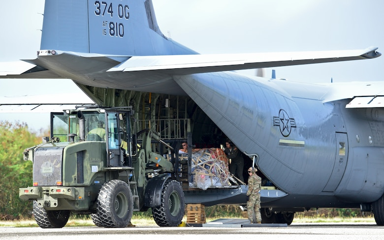 U.S. Air Force (USAF), Koku Jieitai (Japan Air Self-Defense) and Royal Australian Air Force (RAAF) members utilize a USAF C-130J Super Hercules to perform logistical re-supply, medical evacuation, troop movement and humanitarian assistance during exercise COPE NORTH 18 at Tinian, U.S. Commonwealth of the Northern Marianas Islands, Feb. 20. Through exercises and engagements during COPE NORTH, USAF, Koku Jieitai and RAAF increase interoperability for humanitarian assistance/disaster relief operations. (U.S. Air Force photo by Airman 1st Class Christopher Quail)