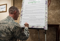 U.S. Air Force Chief Master Sgt. Thomas Daniels, 39th Air Base Wing command chief, signs the Military Saves Week proclamation