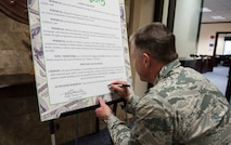 U.S. Air Force Col. David Eaglin, 39th Air Base Wing commander, signs the Military Saves Week proclamation