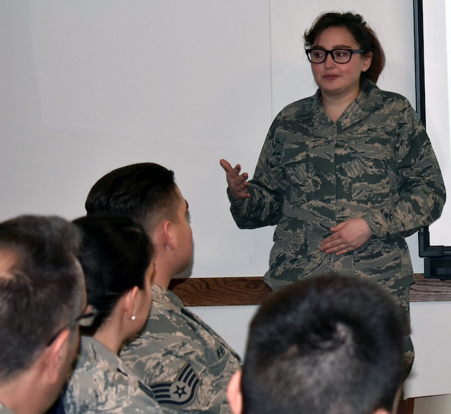 The 71st Intelligence Squadron's honorary member, Tori, speaks to members of the unit during the Jan. 21, 2018 unit training assembly.