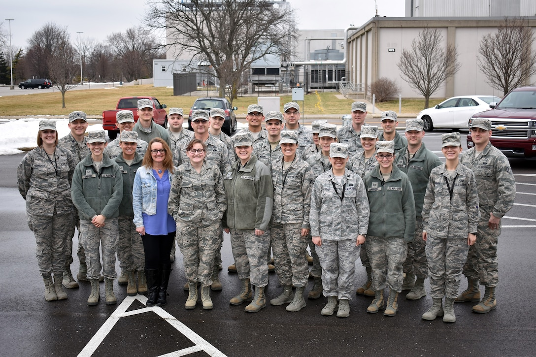 Members of the 655th Intelligence, Surveillance and Reconnaissance Group's 71st Intelligence Squadron pose with honorary squadron member Tori and her mother Shelley, during the Jan. 21, 2018 unit training assembly here